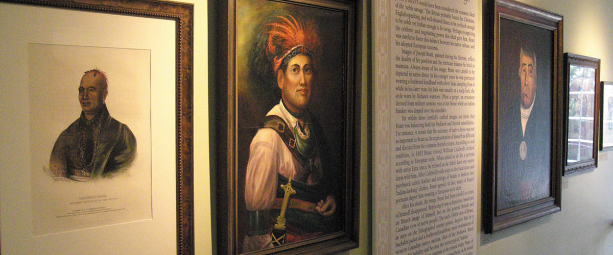 Wall of original paintings of Joseph Brant in Joseph Brant Museum