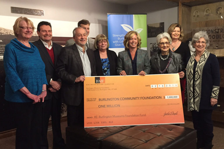 Burlington Museums Foundation board members Elaine Scrivener, Carol D'Amelio, Rick Craven, Nancy Cassady and Rob Stonehewer present a cheque for one million dollars to Colleen Mulholland President and CEO of the Burlington Foundation