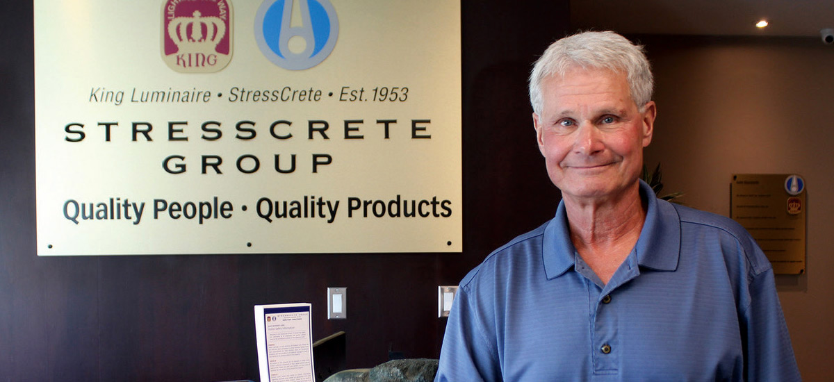 Michael Schwenger stands in front of Stresscrete Group company sign